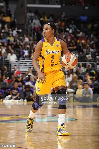 Candice Wiggins of the Los Angeles Sparks handles the ball against the Seattle Storm at STAPLES Center on August 15 2014 in Los Angeles California...