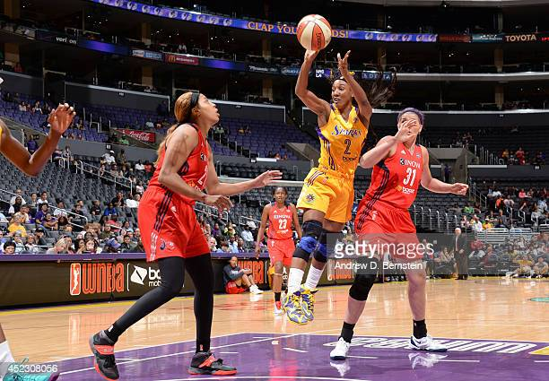 Candice Wiggins of the Los Angeles Sparks passes the ball during a game against the Washington Mystics at STAPLES Center on July 17 2014 in Los...