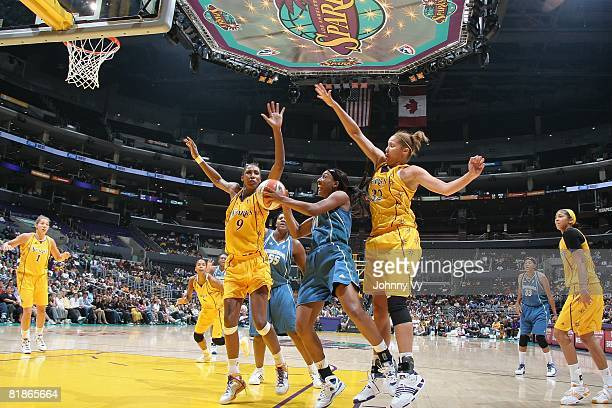 Candice Wiggins of the Minnesota Lynx attempts to shoot against Christi Thomas and Lisa Leslie of the Los Angeles Sparks during the game on July 3...
