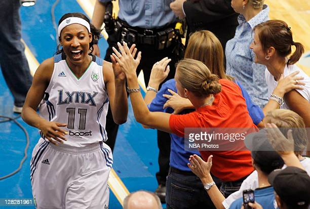 Candice Wiggins of the Minnesota Lynx celebrates with fans after defeating the Atlanta Dream 10192 in Game Two of the 2011 WNBA Finals on October 5...