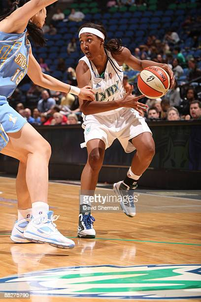 Candice Wiggins of the Minnesota Lynx dribbles against Chen Nan of the Chicago Sky on June 6 2009 at the Target Center in Minneapolis Minnesota NOTE...