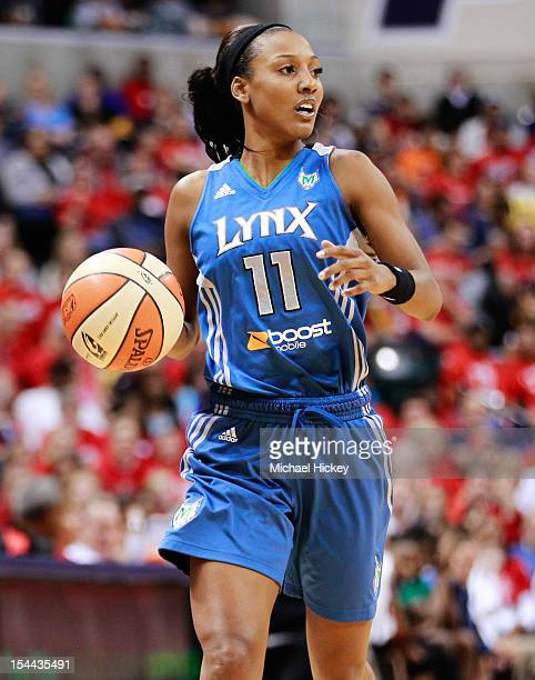 Candice Wiggins of the Minnesota Lynx dribbles the ball up court against the Indiana Fever during Game Three of the 2012 WNBA Finals on October 19...