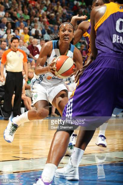 Candice Wiggins of the Minnesota Lynx drives the ball against the Los Angeles Sparks during the WNBA game on September 4 2012 at Target Center in...