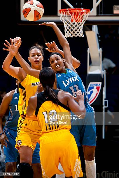 Candice Wiggins of the Minnesota Lynx fails to block a pass by Ivory latta to Liz Cambage # of the Tulsa Shock during the WNBA game on June 30 2011...