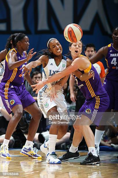 Candice Wiggins of the Minnesota Lynx goes for the ball against Jenna O'Hea of the Los Angeles Sparks during the WNBA game on September 4 2012 at...