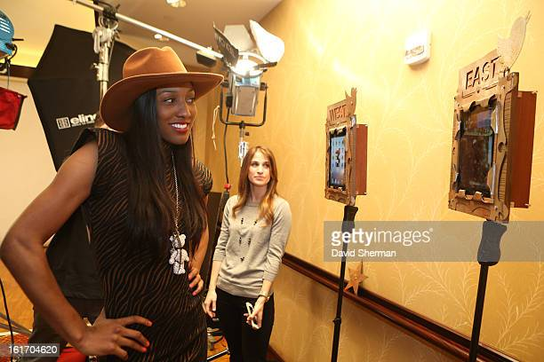 Candice Wiggins of the Minnesota Lynx goes to take some portraits during the NBAE Circuit as part of the 2013 NBA AllStar Weekends at the Hilton...