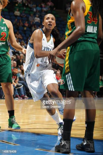 Candice Wiggins of the Minnesota Lynx goes up against Victoria Dunlap of the Seattle Storm during the game on June 6 2012 at Target Center in...