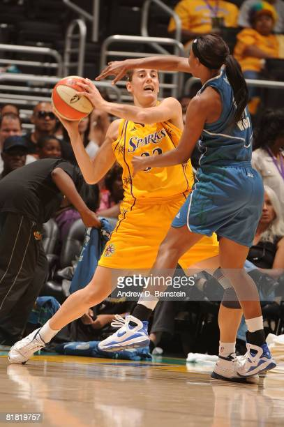 Candice Wiggins of the Minnesota Lynx guards Raffaella Masciadri of the Los Angeles Sparks during the game on July 3 2008 at Staples Center in Los...