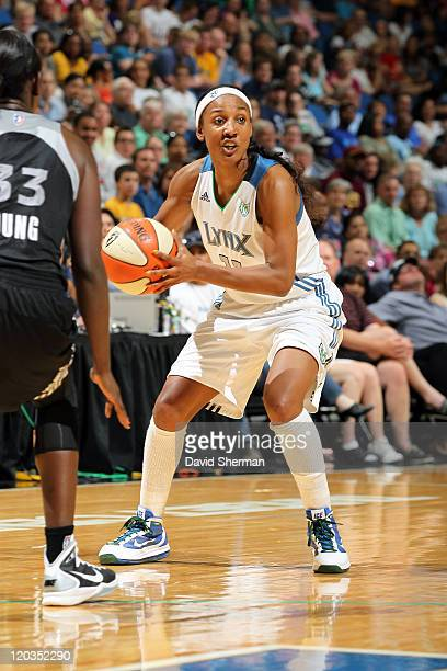 Candice Wiggins of the Minnesota Lynx looks for the pass against Sophia Young of the San Antonio Silver Stars during the game on August 4 2011 at...