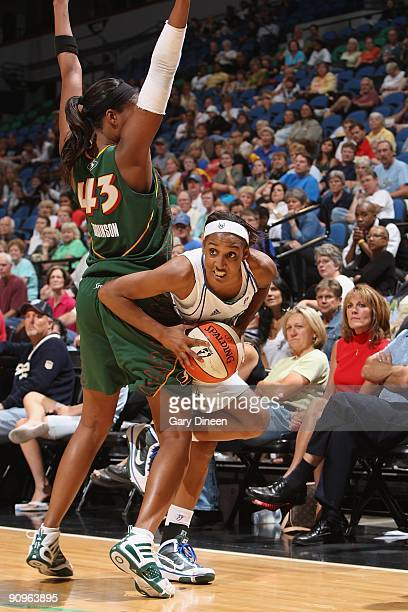 Candice Wiggins of the Minnesota Lynx looks to move the ball against Ashley Robinson of the Seattle Storm during the game on September 5 2009 at...