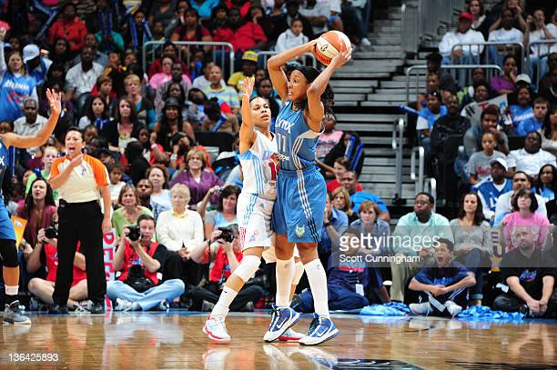 Candice Wiggins of the Minnesota Lynx looks to pass against Lindsey Harding of the Atlanta Dream during Game Three of the 2011 WNBA Finals at Philips...