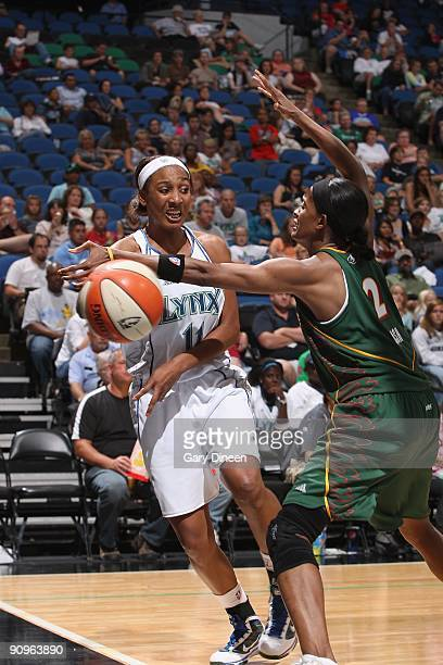 Candice Wiggins of the Minnesota Lynx looks to pass against Swin Cash of the Seattle Storm during the game on September 5 2009 at Target Center in...