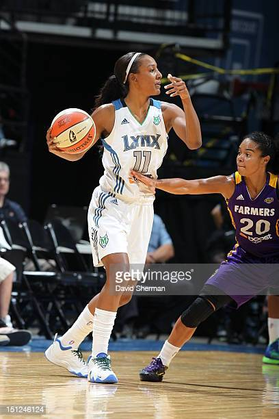 Candice Wiggins of the Minnesota Lynx looks to the pass the ball against Kristi Toliver of the Los Angeles Sparks during the WNBA game on September 4...