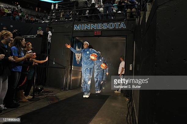 Candice Wiggins of the Minnesota Lynx makes her way to the floor for warmups before the game against the Atlanta Dream in Game One of the 2011 WNBA...