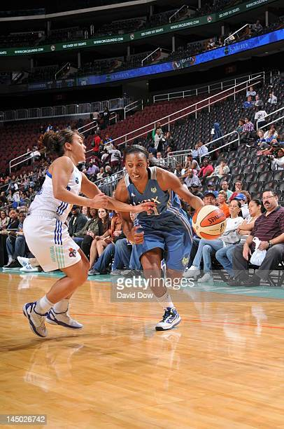 Candice Wiggins of the Minnesota Lynx moves the ball against Leilani Mitchell of the New York Liberty during the WNBA game on May 22 2012 at the...