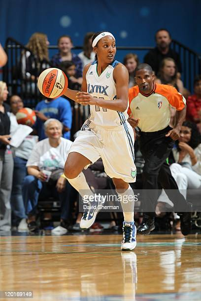 MINNEAPOLIS MN JULY Candice Wiggins of the Minnesota Lynx moves the ball against the Los Angeles Sparks on July 26 2011 at Target Center in...