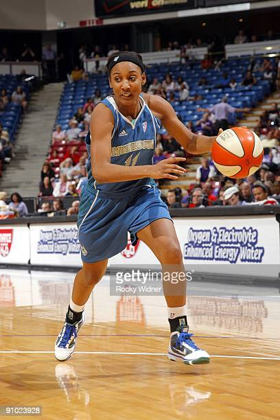 Candice Wiggins of the Minnesota Lynx moves the ball up court during the game against the Sacramento Monarchs at Arco Arena on September 13 2009 in...