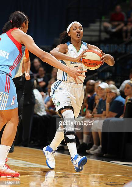 Candice Wiggins of the Minnesota Lynx passes the ball against Iziane Castro Marques of the Atlanta Dream during the game on June 17 2011 at Target...