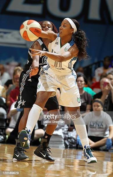 Candice Wiggins of the Minnesota Lynx protects the ball against Danielle Robinson of the San Antonio Silver Stars during the game on August 26 2011...