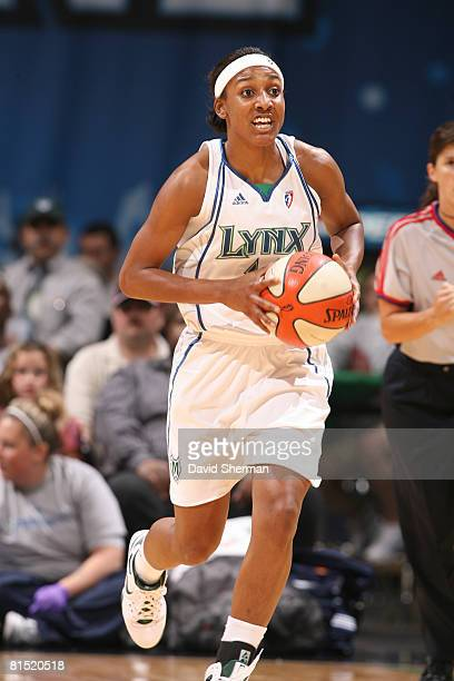 Candice Wiggins of the Minnesota Lynx pushes the ball up court against the Connecticut Sun on June 10 2008 at the Target Center in Minneapolis...