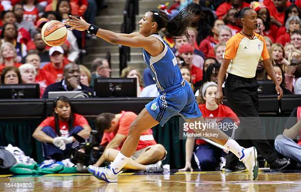 Candice Wiggins of the Minnesota Lynx reaches for a loose ball against the Indiana Fever during Game Three of the 2012 WNBA Finals on October 19 2012...