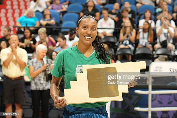 Candice Wiggins of the Minnesota Lynx receives the WNBA Community Assist Award prior to the WNBA game against the San Antonio Silver Stars on August...