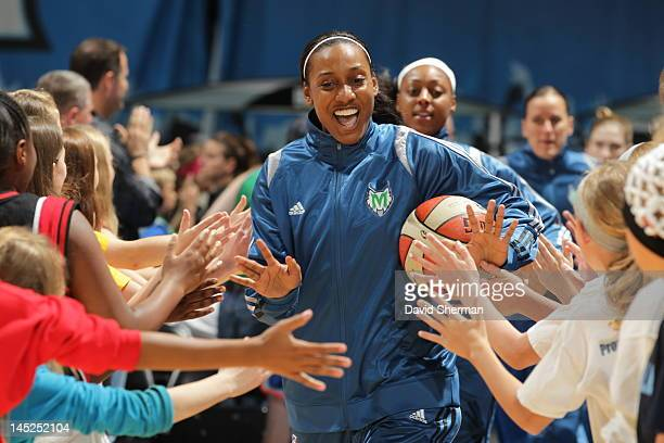 Candice Wiggins of the Minnesota Lynx runs onto the court to start warming up for the game against the Los Angeles Sparks in on May 24 2012 at Target...