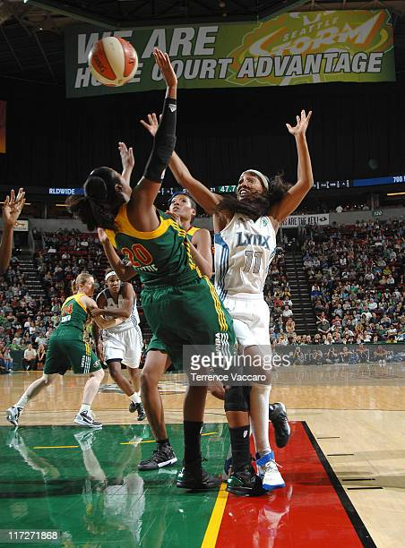Candice Wiggins of the Minnesota Lynx shoots against Camille Little of the Seattle Storm during the game on June 24 2011 at Key Arena in Seattle...