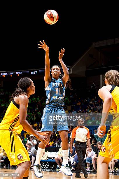 Candice Wiggins of the Minnesota Lynx shoots against Chante Black and Kayla Peterson of the Tulsa Shock during the WNBA game on July 10 2012 at the...