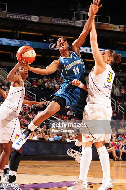 Candice Wiggins of the Minnesota Lynx shoots against Diana Taurasi of the Phoenix Mercury at US Airways Center September 3 2008 in Phoenix Arizona...