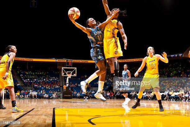 Candice Wiggins of the Minnesota Lynx shoots against Riquna Williams of the Tulsa Shock during the WNBA game on July 10 2012 at the BOK Center in...