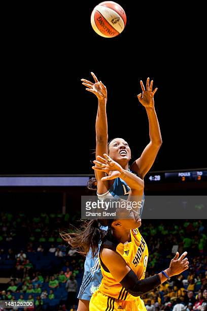 Candice Wiggins of the Minnesota Lynx shoots against Temeka Johnson of the Tulsa Shock during the WNBA game on July 10 2012 at the BOK Center in...