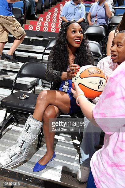Candice Wiggins of the Minnesota Lynx signs autographs during the game against the Seattle Storm on August 1 2010 at the Target Center in Minneapolis...