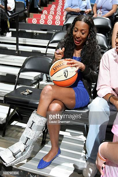 Candice Wiggins of the Minnesota Lynx signs autographs during the game against the Seattle Storm during a WNBA game at the Target Center on August 1...