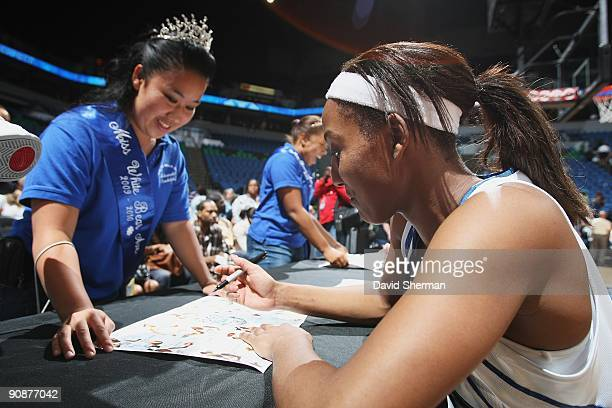 Candice Wiggins of the Minnesota Lynx signs autographs for fans following the game against the Detroit Shock on September 9 2009 at the Target Center...