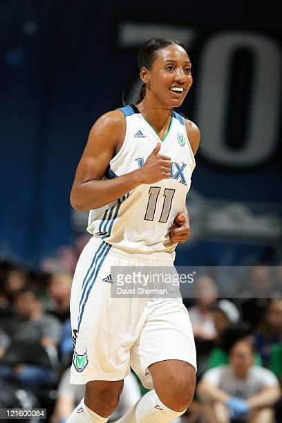 Candice Wiggins of the Minnesota Lynx smiles after a successful shot during the game against the Los Angeles Sparks on August 20 2011 at Target...