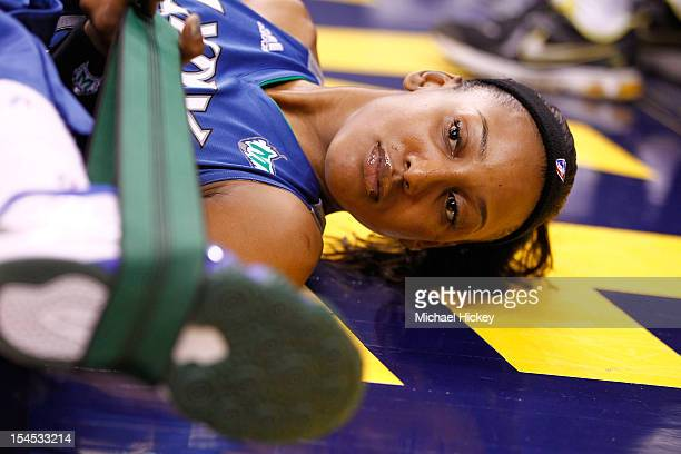 Candice Wiggins of the Minnesota Lynx stretches before playing against the Indiana Fever in Game Four of the 2012 WNBA Finals on October 21 2012 at...