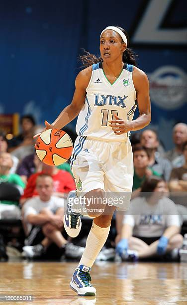 Candice Wiggins of the Minnesota Lynx takes the ball down the court during the game against the Seattle Storm on July 29 2011 at Target Center in...