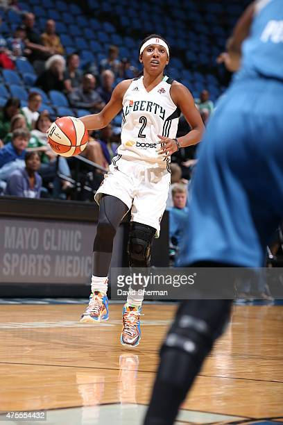 Candice Wiggins of the New York Liberty brings the ball up court against the Minnesota Lynx on June 1 2015 at Target Center in Minneapolis Minnesota...