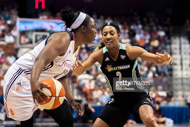 Candice Wiggins of the New York Liberty defends Chelsea Gray of the Connecticut Sun on August 14 2015 at the Mohegan Sun Arena in Uncasville...