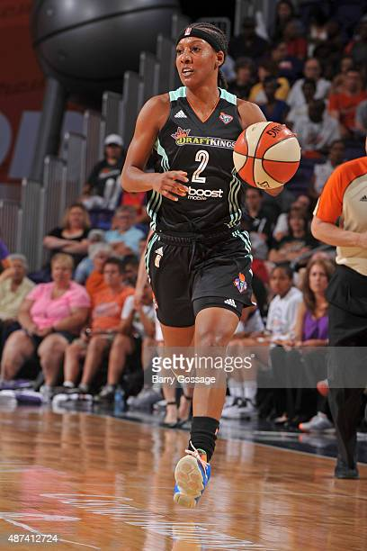 Candice Wiggins of the New York Liberty dribbles the ball against the Phoenix Mercury on July 18 2015 at Talking Stick Resort Arena in Phoenix...