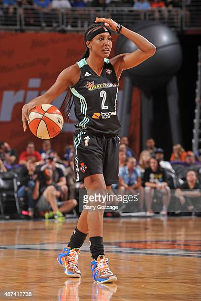 Candice Wiggins of the New York Liberty dribbles the ball and calls a play against the Phoenix Mercury on July 18 2015 at Talking Stick Resort Arena...