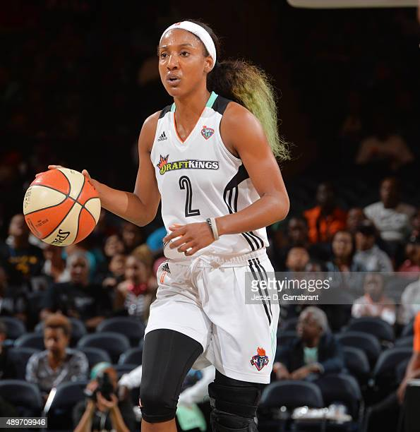 Candice Wiggins of the New York Liberty dribbles up the court against the Indiana Fever during game One of the WNBA Eastern Conference Finals at...