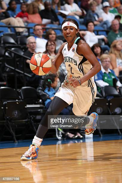 Candice Wiggins of the New York Liberty drives to the basket against the Minnesota Lynx on June 1 2015 at Target Center in Minneapolis Minnesota NOTE...