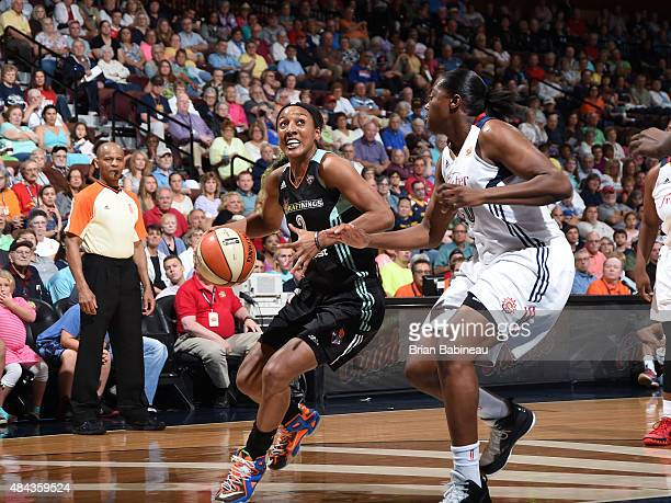 Candice Wiggins of the New York Liberty drives to the basket against the Connecticut Sun on August 14 2015 in Uncasville Connecticut NOTE TO USER...