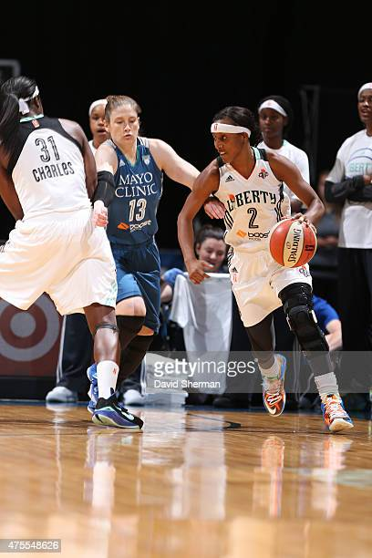 Candice Wiggins of the New York Liberty handles the ball against Lindsay Whalen of the Minnesota Lynx on June 1 2015 at Target Center in Minneapolis...