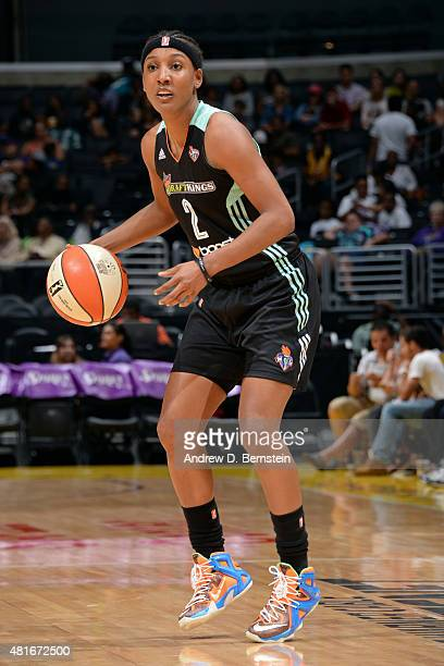 Candice Wiggins of the New York Liberty handles the ball against the Los Angeles Sparks at Staples Center on July 22 2015 in Los Angeles California...