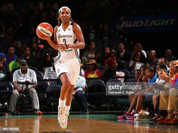 Candice Wiggins of the New York Liberty handles the ball against the Tulsa Shock on August 15 2015 at Madison Square Garden New York City New York...