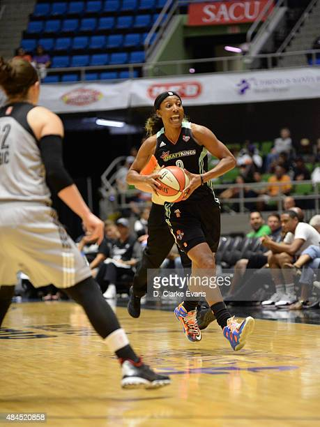 Candice Wiggins of the New York Liberty passes the ball against the San Antonio Stars on August 19 2015 at the Freeman Coliseum in San Antonio Texas...