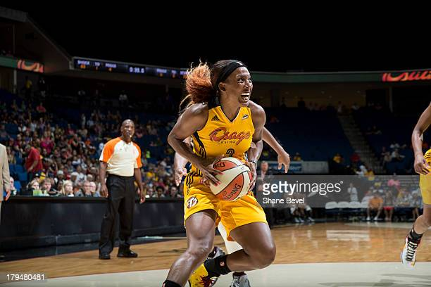 Candice Wiggins of the Tulsa Shock drives to the basket during the WNBA game against the San Antonio Silver Stars on August 30 2013 at the BOK Center...
